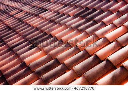 Repeating terracotta tiles on a roof in Italy