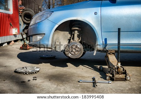 Replacement tires on the car at the service station - stock photo
