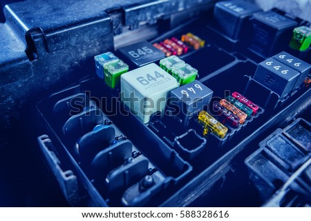 replacing fuses fuse box car car stock photo (edit now) 588328616 fuse box wiring diagram replacing fuses in the fuse box of the car car repair service station