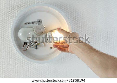 Replacing incandescent lamp in favor of fluorescent, as more and more countries outlaw incandescent bulbs. - stock photo