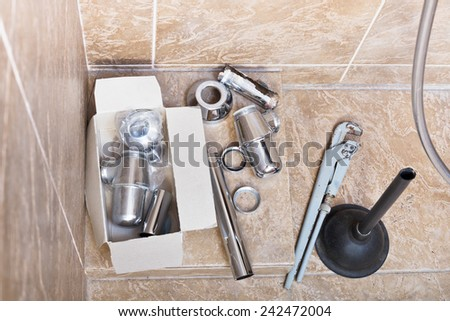 replacing of corroded plumbing trap from sink in bathroom - stock photo