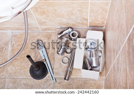 replacing of rusted plumbing trap from sink in bathroom - stock photo