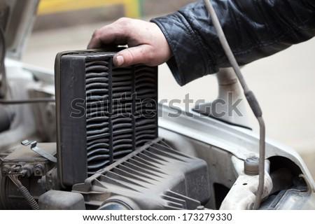 replacing the air filter, car repair  - stock photo