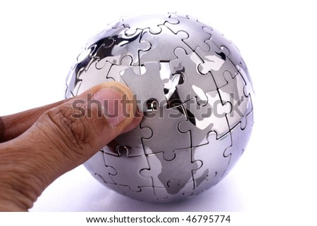 Replacing the missing jigsaw puzzle piece - stock photo