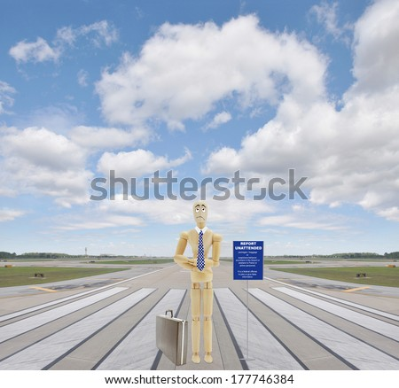 Report Unattended Baggage / Packages or suspicious behavior anywhere in the airport or plane to police or airline personnel. It is a federal offense to joke or give false information. Airport Runway - stock photo