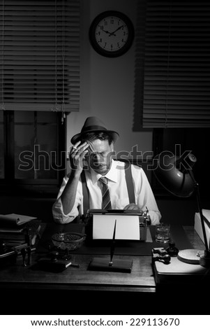 Reporter working late at night and smoking in his office, 1950s film noir style.
