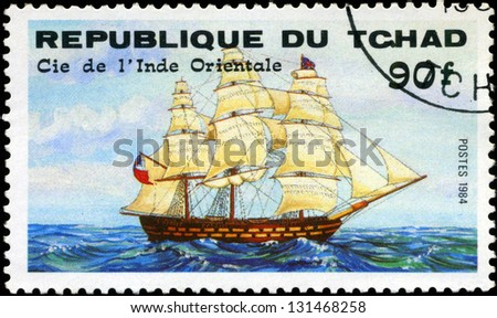 "REPUBLIC OF CHAD - CIRCA 1984: A stamp printed in Republic of Chad shows the ship ""Cie de l'Inde Orientale"", series is devoted to sailing vessels, circa 1984 - stock photo"
