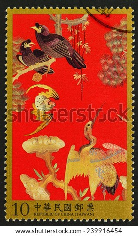 REPUBLIC OF CHINA (TAIWAN) - CIRCA 2013: A stamp printed in Taiwan shows image of Qing auspicious Crow crane bat embroidery patterns antiques , circa 2013