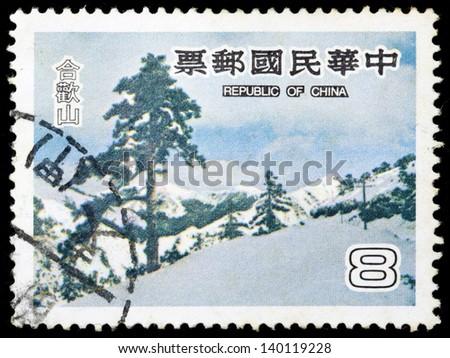 REPUBLIC OF CHINA (TAIWAN) -CIRCA 1980: A stamp printed in the Taiwan, shows the beautiful Hehuan Mountain during winter, circa 1980 - stock photo