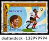 REPUBLIC OF EQUATORIAL GUINEA - CIRCA 1974: A stamp printed in the Republic of Equatorial Guinea shows football player (world Cup : Munich, Germany) and portrait Beckenbauer (Germany), circa 1974. - stock photo