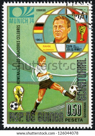 REPUBLIC OF EQUATORIAL GUINEA - CIRCA 1974: A stamp printed in the Republic of Equatorial Guinea shows football player (Champions Cup : Munich, Germany) and portrait Rahn(Germany), circa 1974. - stock photo