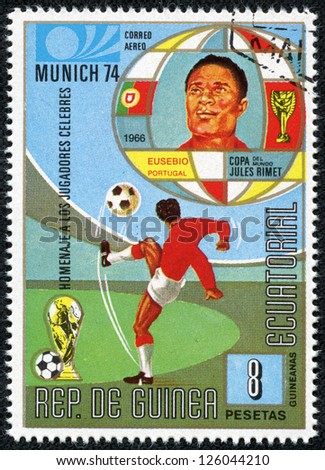 REPUBLIC OF EQUATORIAL GUINEA - CIRCA 1974: A stamp printed in the Republic of Equatorial Guinea shows football player (Champions Cup : Munich, Germany) and portrait of Eusebio (Portugal), circa 1974. - stock photo
