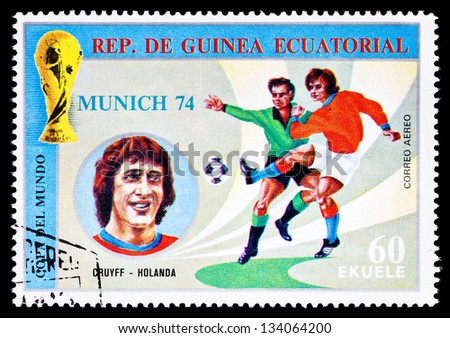 REPUBLIC OF EQUATORIAL GUINEA - CIRCA 1974: A stamp printed in the Republic of Equatorial Guinea shows football player (Champions Cup : Munich, Germany) and portrait Cruyff (Holland), circa 1974. - stock photo
