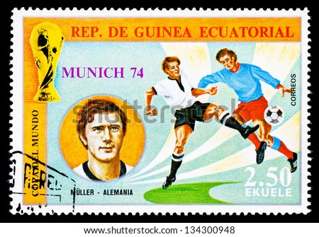 REPUBLIC OF EQUATORIAL GUINEA - CIRCA 1974: A stamp printed in the Republic of Equatorial Guinea shows football player (World Cup : Munich, Germany) and portrait Muller (Germany), circa 1974. - stock photo