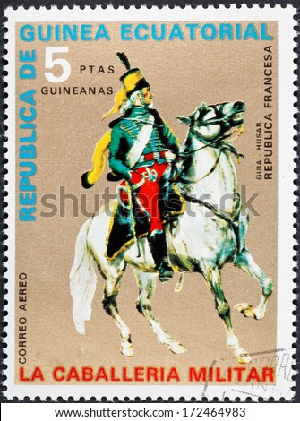 REPUBLIC OF EQUATORIAL GUINEA Guinea - CIRCA 1976: A postage stamp printed in the Equatorial Guinea shows army uniform of military cavalry - hussar officer of French Republic, circa 1976
