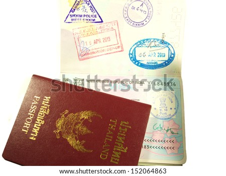 Republic of India Visa with permit stamps and Thailand passport book.