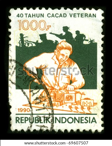 REPUBLIC OF INDONESIA - CIRCA 1990:A stamp printed in REPUBLIC OF INDONESIA shows image of the 40-year veteran disability circa 1990 - stock photo