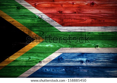 Republic of South Africa flag on a weathered natural wooden surface close-up - stock photo
