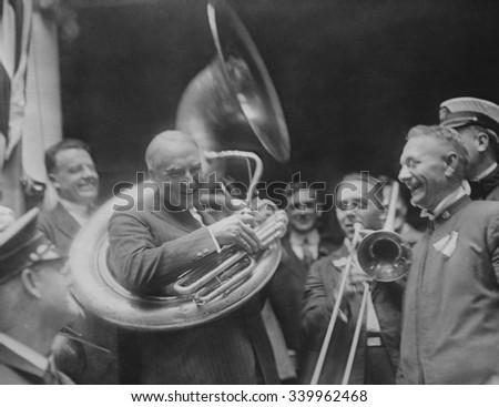 Republican Presidential nominee Warren Harding encircled by a sousaphone. August 1920. This created an amusing image for his 'front porch' campaign in 1920. - stock photo