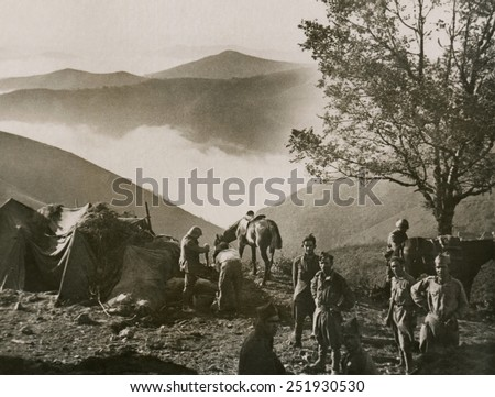 Republican troops in camp in the Pyrenees foothills with grand mountainous scenery. The Basques and Catalans separatists sided against the Nationalists in hopes of independence from Spain. 1936-39. - stock photo