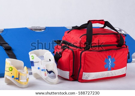 Rescue bag, cervical collars and stretcher on white background - stock photo