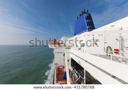 rescue boat on a large ferry boat - stock photo