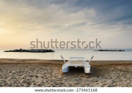 rescue boat on the deserted beach in summer - stock photo