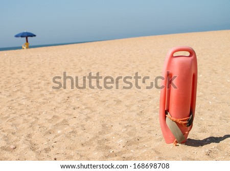 Rescue buoy in the sand / Rescue Buoy - stock photo