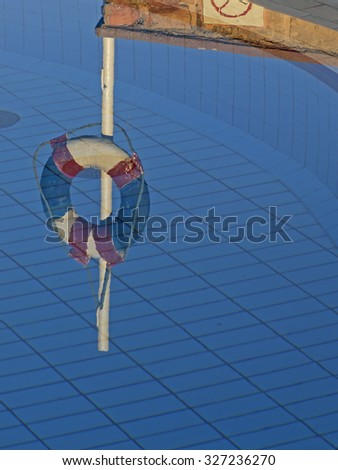 Rescue equipment by the poolside - stock photo