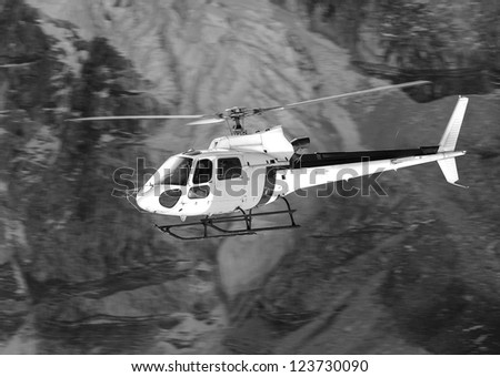 Rescue helicopter above the Everest Base Camp - Nepal, Himalayas (black and white) - stock photo