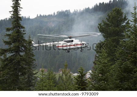 Rescue helicopter landing weather station - stock photo