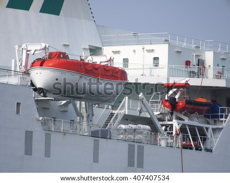 rescue lifeboat of ferryboat on sky  background  - stock photo