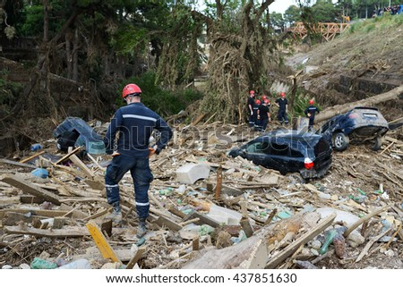 Rescue Service assorted debris after floods - stock photo
