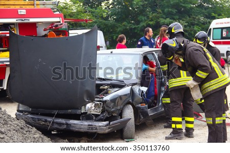 Rescue simulation of accident. Val Della Torre, Italy - September, 28 2014: Simulation of road accidents, joint intervention between firefighters and rescuers.