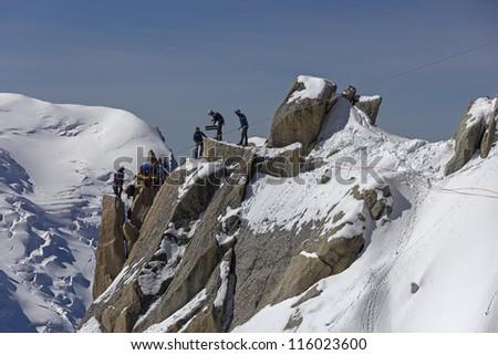 Rescue team climb in montain - stock photo