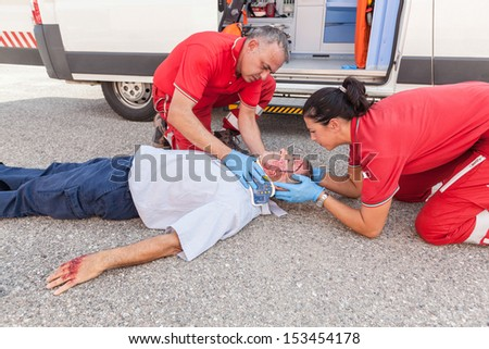 Rescue Team Providing First Aid - stock photo