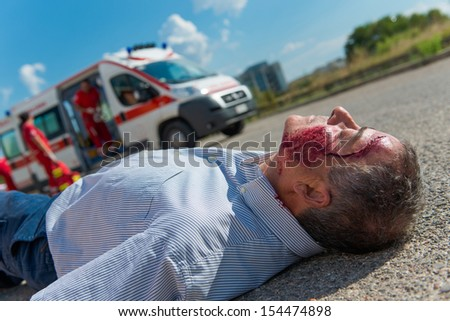Rescue Team Providing First Aid,Italy - stock photo