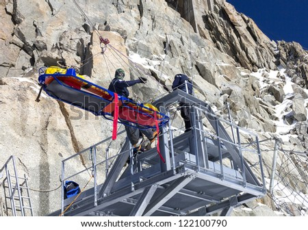 Rescue team training in mountain - stock photo