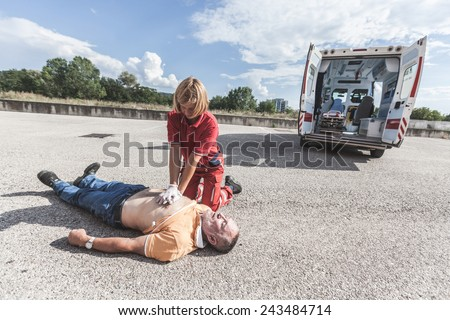 Rescuer Practicing Heart Massage - stock photo