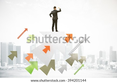 Research concept with businessman standing on colorful arrows, looking into the distance on foggy city background - stock photo