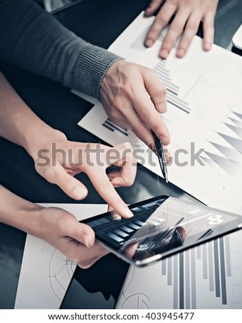 Research department working process.Photo woman showing business reports modern tablet. Statistics graphics screen.Banker holding pen for signs documents,discussion startup idea. Vertical.Film effect