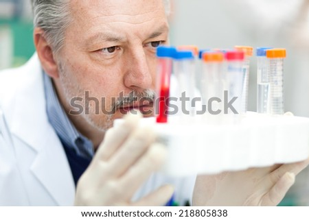 Researcher at work in a laboratory - stock photo