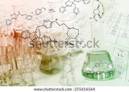 researcher pour the solution from flask to another flask in laboratory with chemical equations and periodic table background. - stock photo