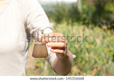 researcher testing the water quality - stock photo