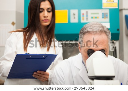Researchers at work in a laboratory - stock photo