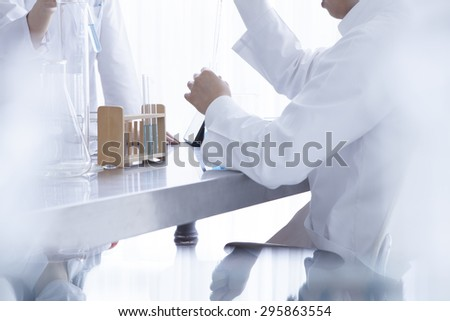 Researchers carrying out scientific research in a lab  - stock photo