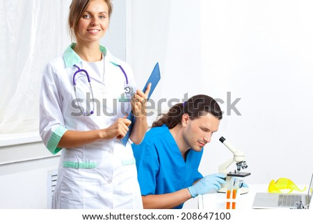 researchers in the biological laboratory - stock photo