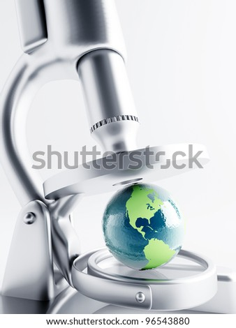 Researching of earth globe under magnification with microscope