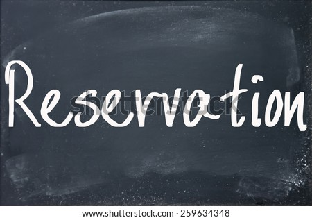 reservation word write on blackboard - stock photo