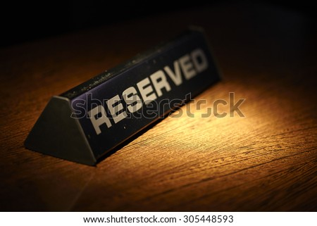 Reserved plate on a table in a restaurant